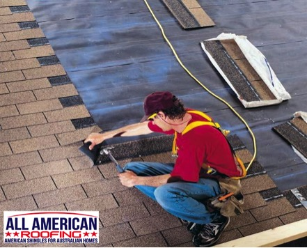 Installing asphalt roof shingles on roof